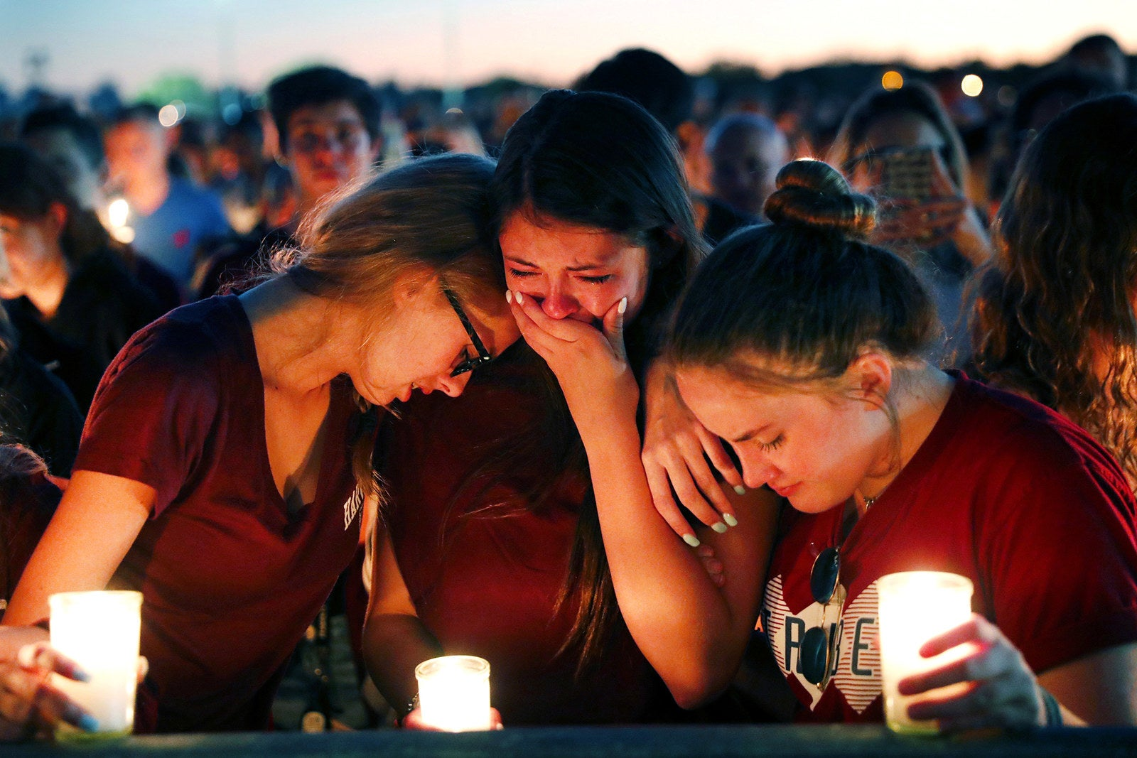 Students console each other during a candlelight vigil on Feb. 15 for the victims of the shooting at Marjory Stoneman Douglas High School.