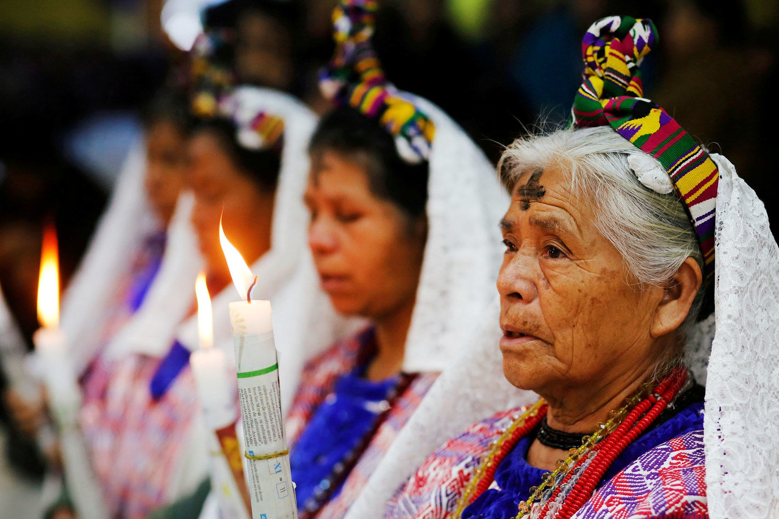 Indigenous Mayan women, with a cross of ashes on their foreheads, attend an Ash Wednesday mass in the municipality of San Juan Sacatepéquez, Guatemala, on Feb. 14.