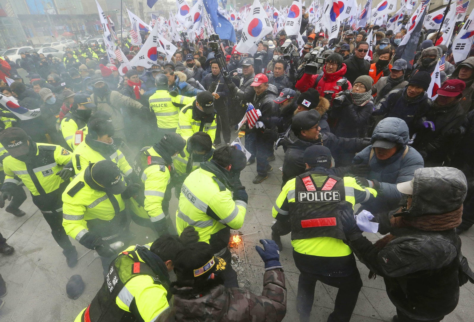 Protesters scuffle with police officers during a rally protesting North Korea's participation in the Pyeongchang 2018 Winter Olympics, in Seoul on Feb. 11.