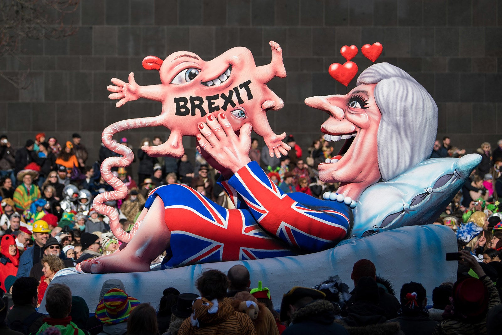 A float mocking Prime Minister Theresa May rolls past spectators during the annual Rose Monday parade on Feb. 12, in Dusseldorf, Germany. Political satire is a traditional cornerstone of the annual parades.
