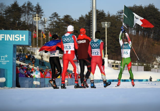 At the finish, his fellow skiers and competitors from Colombia, Tonga, Morocco, and Portugal waited to congratulate him and give him a proper hero's welcome.