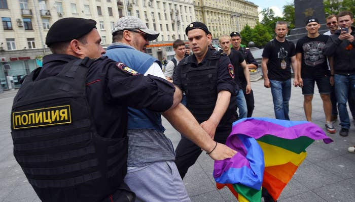 Russian riot police officers detain an LGBT rights activist during an unauthorized rally in central Moscow on May 30, 2015.