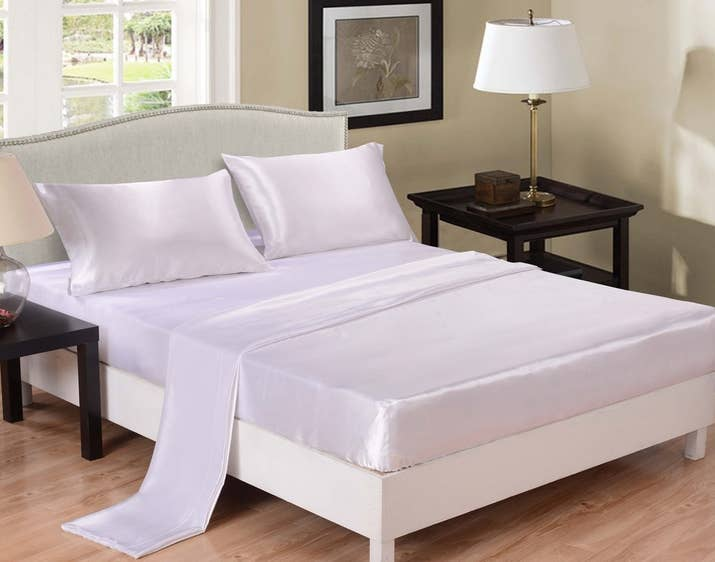 "This set includes: one flat sheet, one fitted sheet, and two pillow cases! They're machine washable, but use cold water.Promising review: ""Material is gorgeous! It's silky, shiny, and soft. They survived the first wash. Looks stunning in a romantically themed bedroom. Will order again in this color and others. I love this item!"" —Tracy D.Get it from Amazon for $24.99+ (available in full–king and in seven colors) or from Walmart for $21+ (available in full–king and in six colors)."