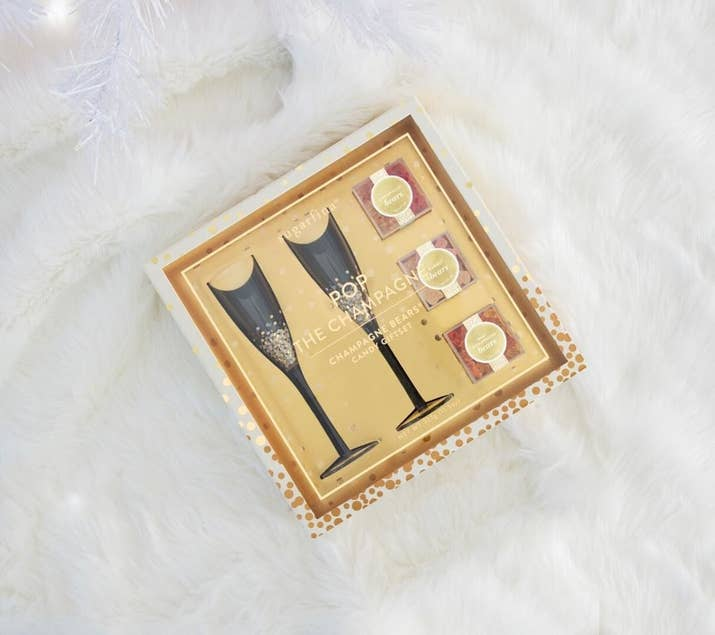 "Promising review: ""This is an amazing gift set. The candies were delicious and the champagne flutes were beautiful. I would highly recommend this as a hostess gift or a treat for yourself."" —Nicole131Get it from Nordstrom for $50."