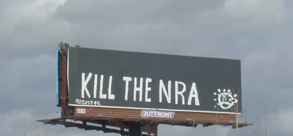 """A billboard in Louisville, Kentucky, was vandalized with the message """"Kill the NRA"""" on Monday, less than a week after 17 people were shot and killed in the high school shooting in Parkland, Florida."""