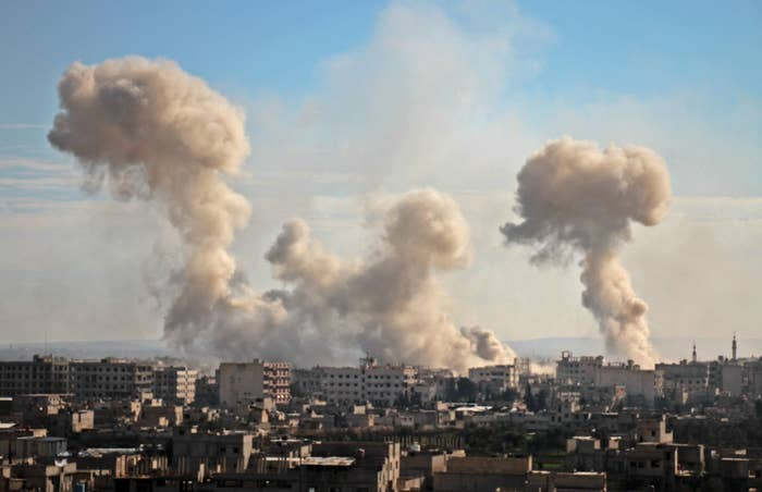 Smoke rises from buildings following a bombardment on the village of Mesraba, Eastern Ghouta.