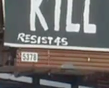 """While speculations of origins of the sign remain unconfirmed, it was tagged with """"Resist 45,"""" a group that's tagged other anti-Trump signs in the Louisville area."""
