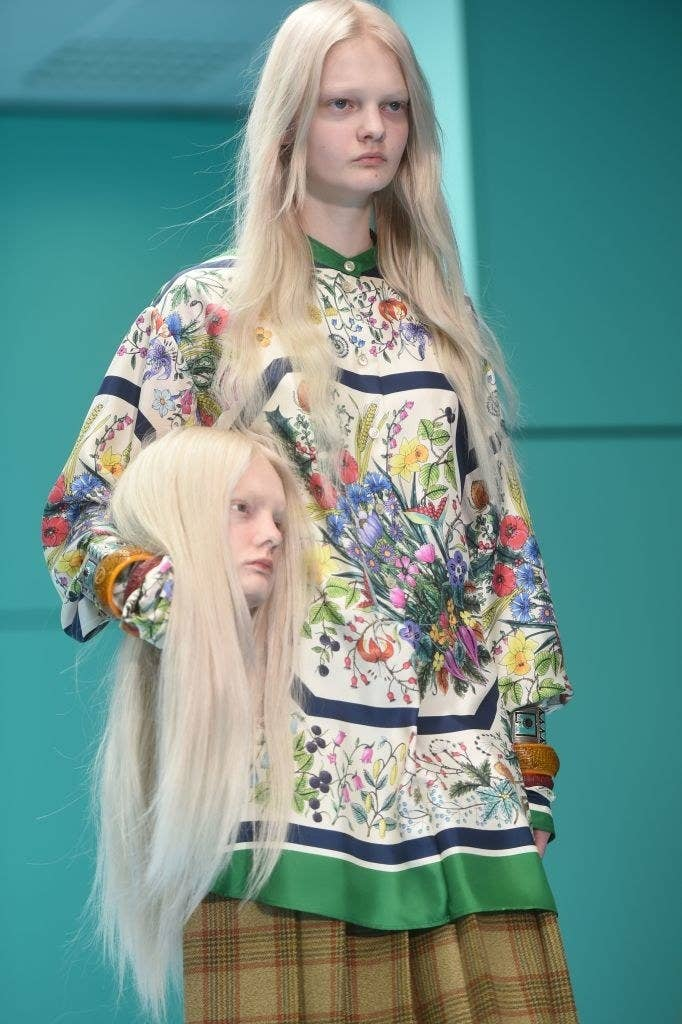 40fa5cbbb14 Gucci Models Carried Replicas Of Their Own Heads Down The Runway And ...