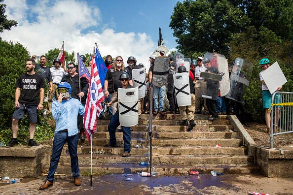 White nationalists stand guard on the steps of Emancipation Park at the Unite the Right rally on Aug. 12, 2017, in Charlottesville, Virginia.