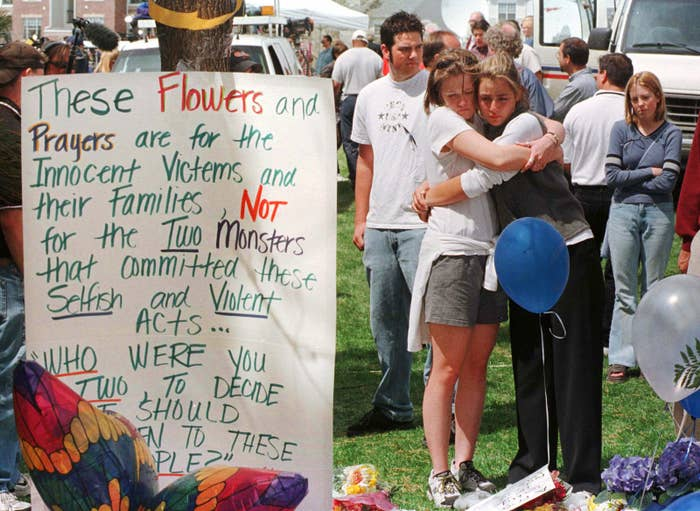 Columbine High School students Sarah Fisicaro, right, and Katie Teitsworth embrace after two teenage shooters killed 13 students before killing themselves in Littleton, Colorado.