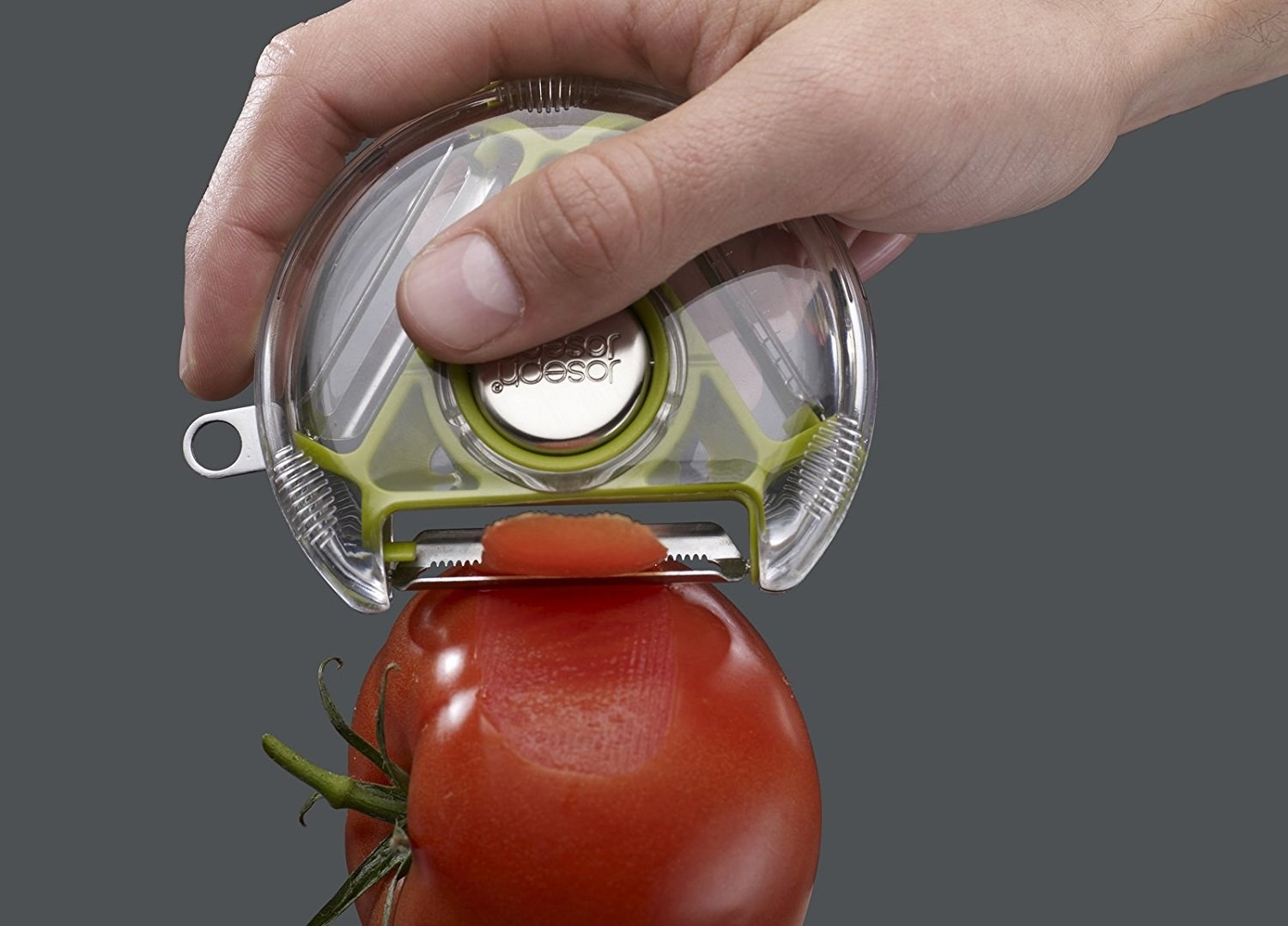 A flat cylindrical vegetable peeler with an open end to expose the desirable blade