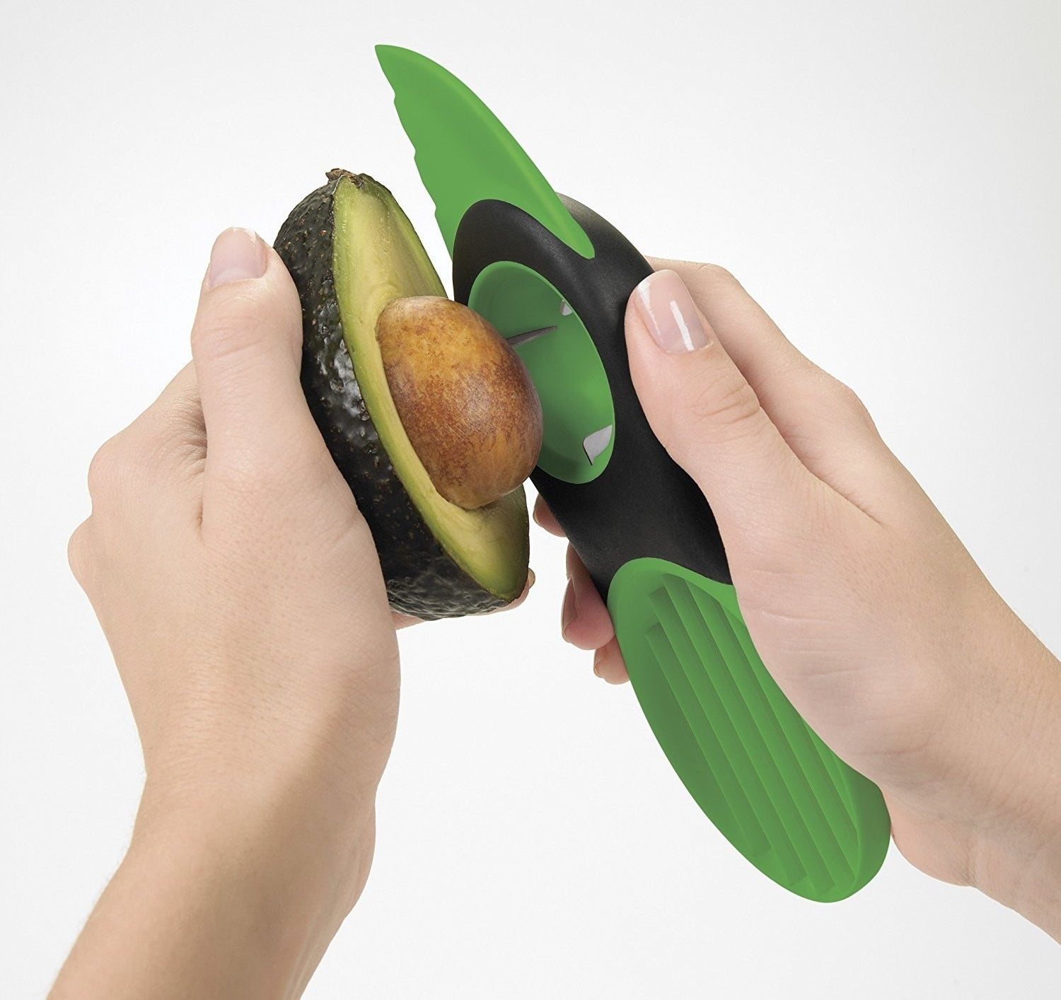 A tool with a knife on one end and a slicer on the other to scoop through the avocado. In the middle, there's a inverted hemisphere to grasp and remove avocado pits