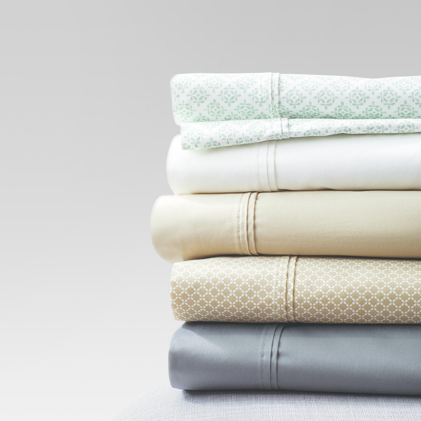 stack of sheets in different colors and patterns