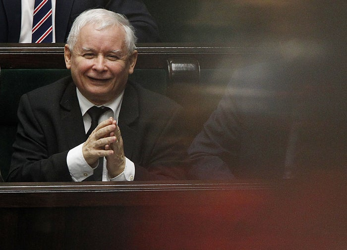 Poland's most powerful politician, ruling Law and Justice party leader Jaroslaw Kaczynski, smiles during a vote in parliament