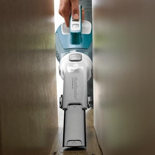 Handheld vacuum between a tight fit from wall to sofa
