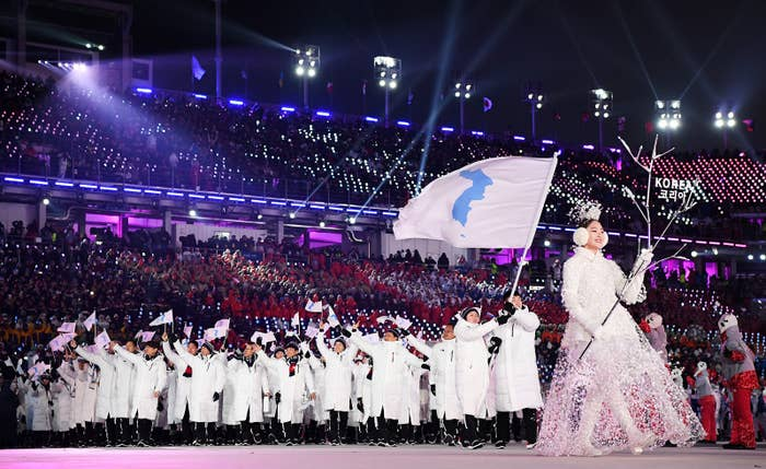 The North Korea and South Korea Olympic teams enter together under the Korean Unification Flag during the opening ceremony Feb. 9.