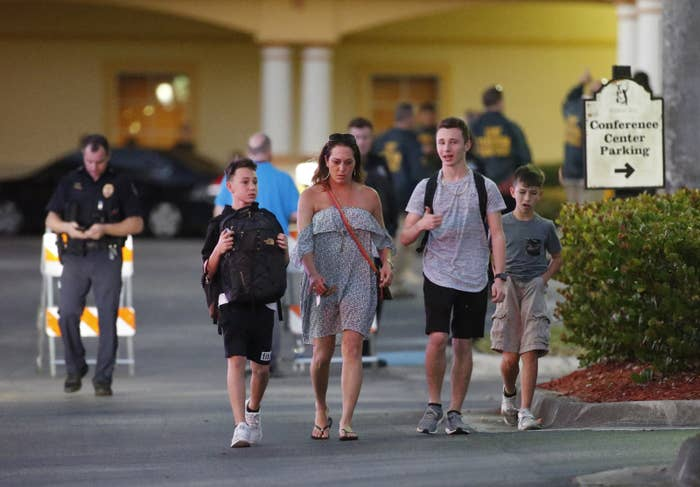 Family members pick up students of Marjory Stoneman Douglas High School in Parkland after the shooting.