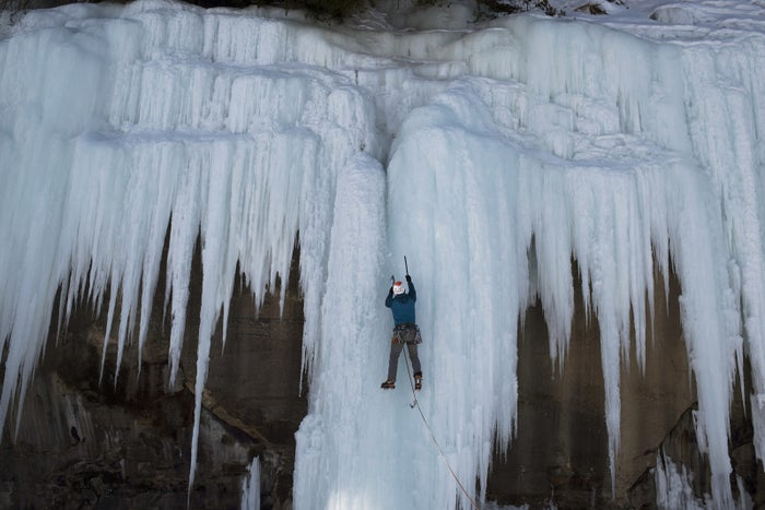 A climber ascends the ice formations on the east side of Grand Island over the frozen waters of Lake Superior.