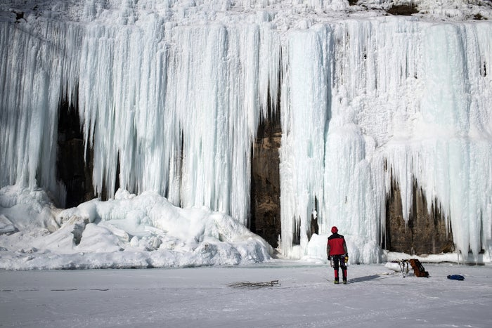 Paul Garrison of Howell, Michigan, looks up at an immense ice formation.