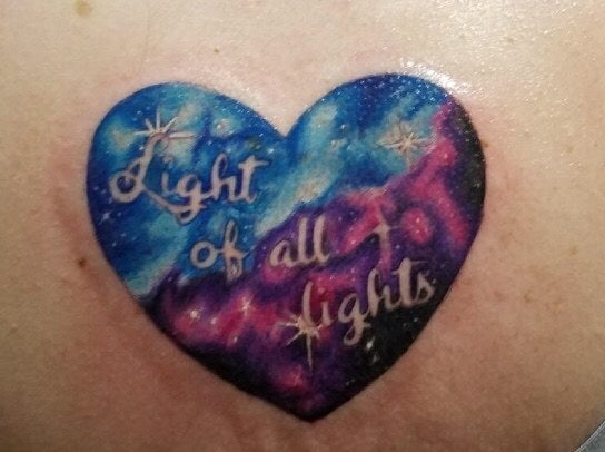 """This tattoo on my back was inspired by a quote I saw for the first time on BuzzFeed! 'There are darknesses in life and there are lights. And you are one the lights. The light of all lights.' My paternal grandfather was very special to me. This tattoo is for him. We both had pain in our lives, moments of darkness. But it's all worth it, remembering that I had a love like that, and I hope it was like that for him too."" — tniendorff"
