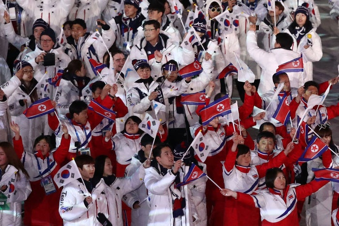 Team Korea and Team Republic of Korea walk in the Parade of the Athletes during the closing ceremony of the Pyeongchang 2018 Winter Olympics.