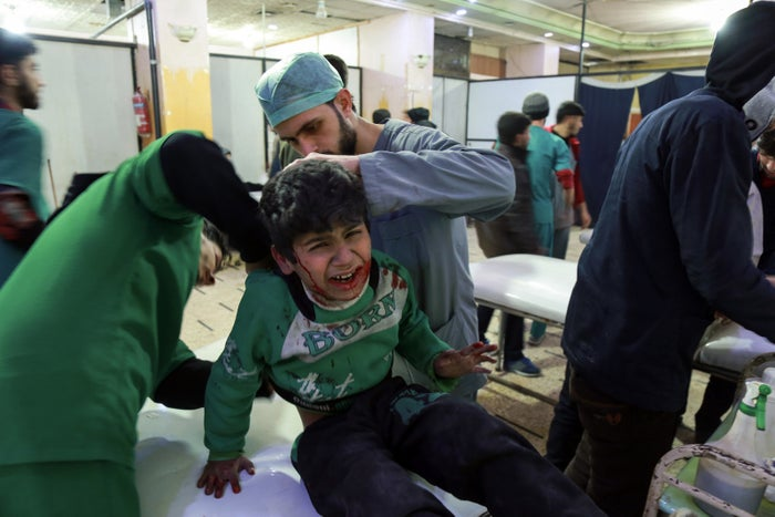 Medics attend an injured child inside Eastern Ghouta, 24 February.