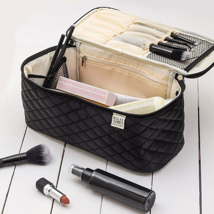 """Promising review: """"This is a well tailored bag with lots of pockets. The zipper works great too. I bought black which has an ivory interior and is lovely and easy to locate items. I use mine to keep everything for doing my nails. I intend to get another for travel."""" —cmsPrice: $29.95."""