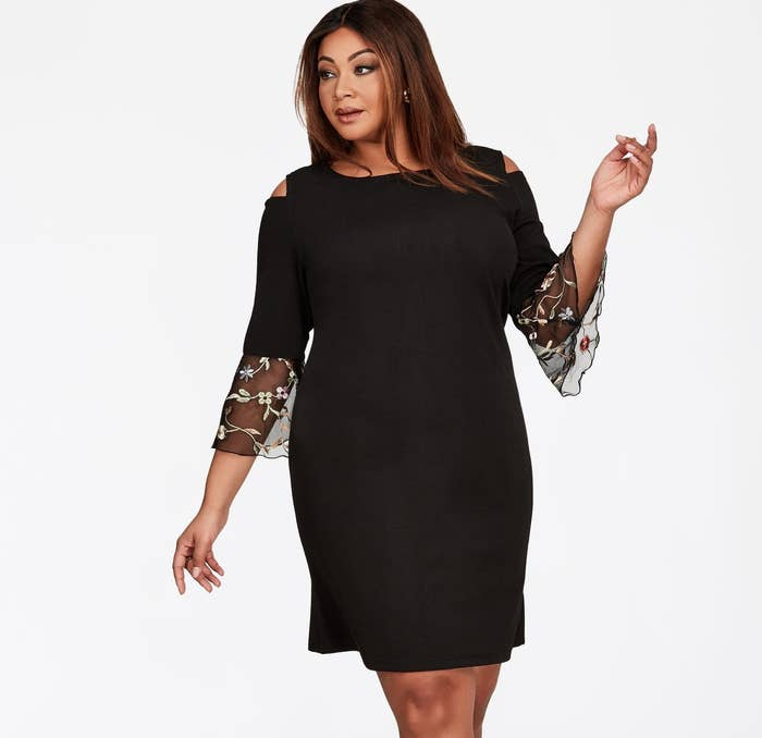 e68122bc0b A sophisticated LBD with cut-out shoulders and mesh sleeves.
