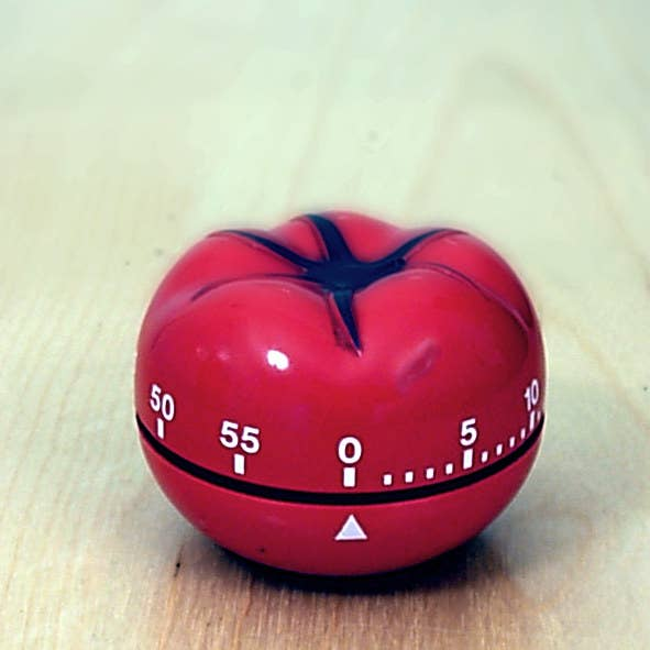 """The Pomodoro technique encourages productivity by breaking down a task into 25-minute bursts of work (also called a """"pomodoro"""".) Every 25 minutes, take a short five-minute break, then move on to another 25-minute burst of activity. Every four """"pomodoros,"""" allow yourself a break longer than five minutes."""