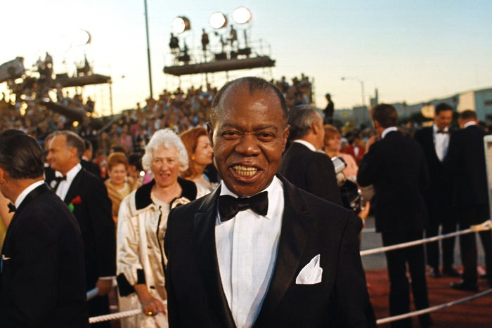 Famed jazz trumpeter Louis Armstrong arrives at the Academy Awards on April 10, 1968.
