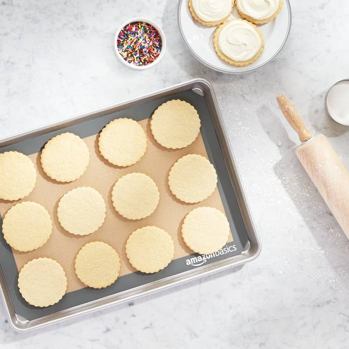 """Promising review: """"My husband purchased this two-pack of baking mats for really cheap! Easy to use, easy to clean, and no more wasting money on foils. I smeared a bit of butter on the mat before placing the cookie dough, and I didn't use any utensil to scoop up the cookies. I waited a few minutes before using my hand to remove it ever so easily from the baking mat and voilà! Happy baker."""" —R1riderGet a pack of two from Amazon for $9.62."""