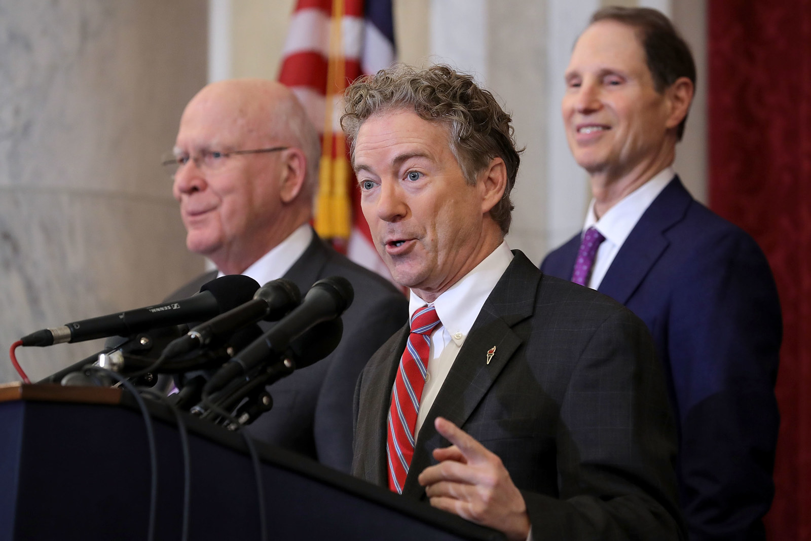 WASHINGTON, DC - JANUARY 16: Sen. Rand Paul (R-KY) (C) answers reporters questions during a news conference with Sen. Patrick Leahy (D-VT) (L) and Sen. Ron Wyden (D-OR) about their proposed reforms to the Foreign Intelligence Surveillance Act in the Russell Senate Office Building on Capitol Hill January 16, 2018 in Washington, DC. The senators are part of a bipartisan group that supports legislation they say would protect Americans from foreign threats while preserving their privacy.
