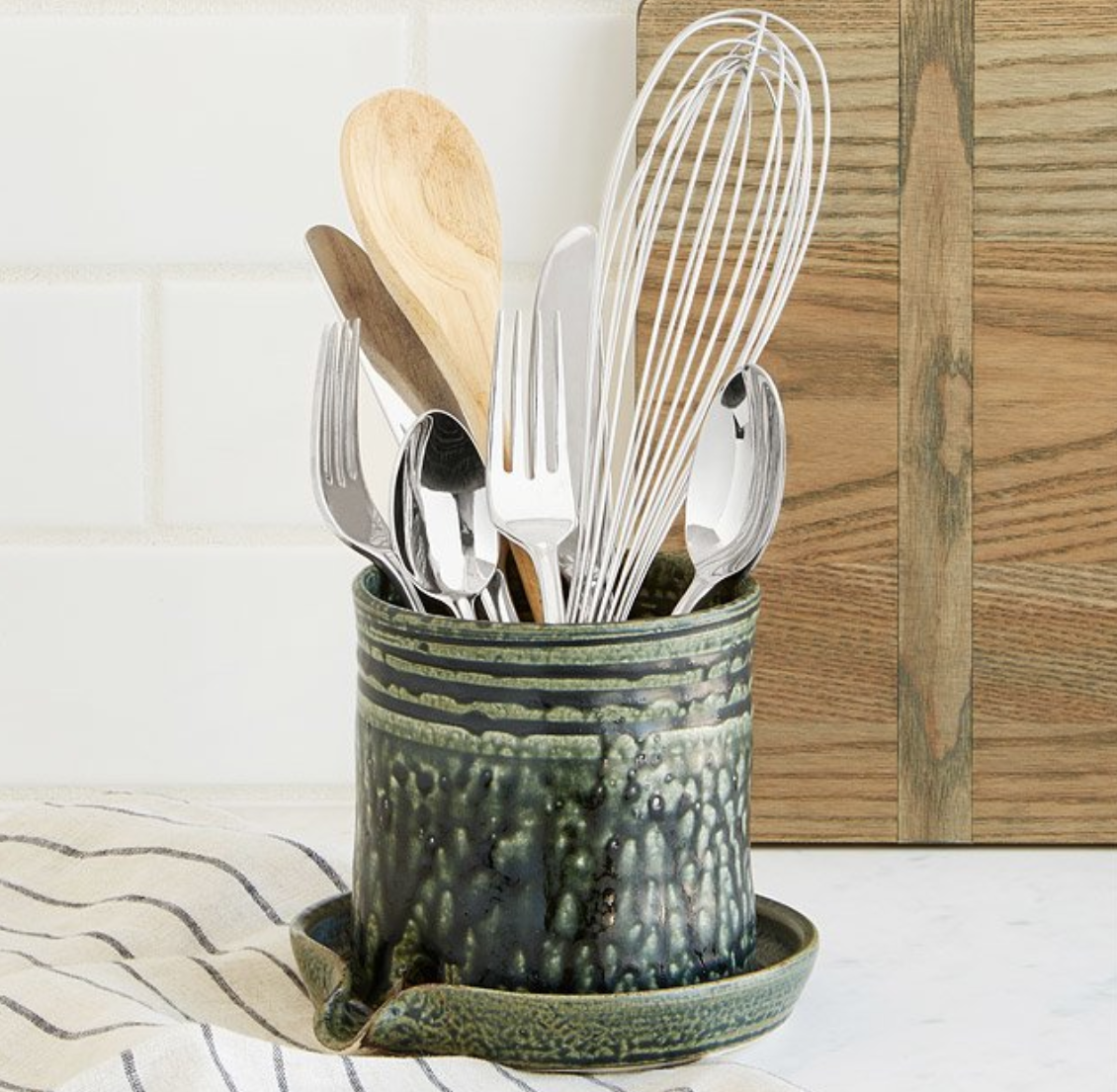 A handy utensil caddy that drains your freshly cleaned kitchen tools right into the sink.