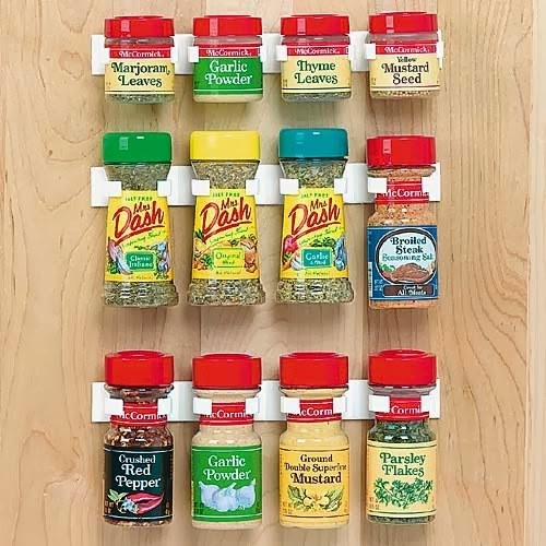 A set of adhesive spice holders for the back of any cabinet door because everyone loves easy access.