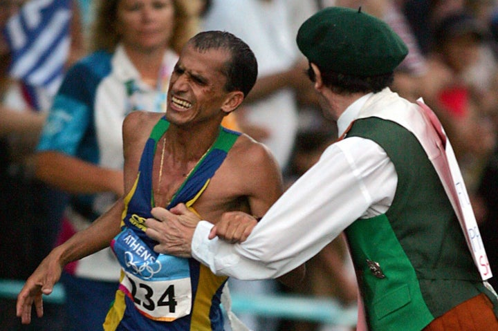Vanderlei de Lima of Brazil is sabotaged by an Irish former priest in 2004.