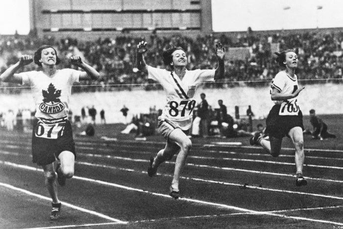 American athlete Betty Robinson (second from left) wins the final of the women's 100-meter event during the Olympic Games in Amsterdam on July 31, 1928.