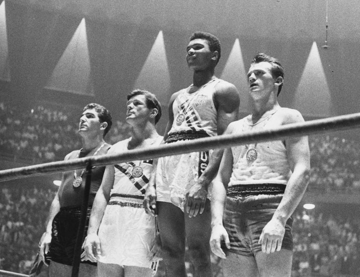 Cassius Clay wins Olympic gold for light heavyweight boxing in 1960.