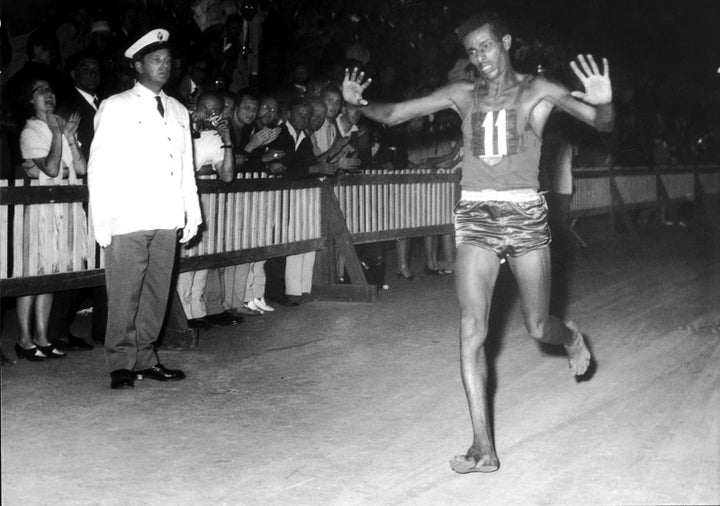 Abebe Bikila of Ethiopia runs the men's marathon final while completely barefoot in 1960 — and wins.