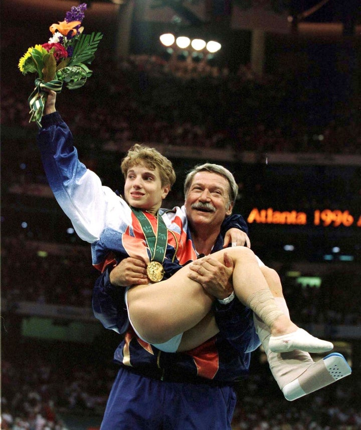 An injured Kerri Strug takes home gold for the USA in 1996.