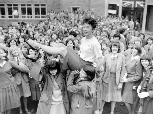 PE teacher Ann Packer of Britain returns to her students as an Olympic champion in 1964.