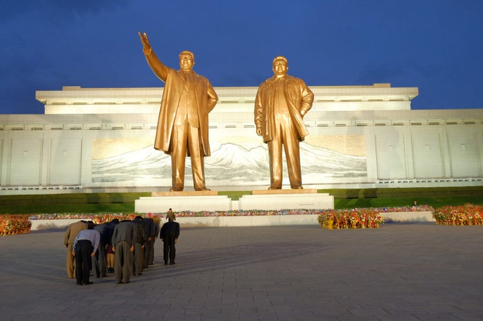 North Koreans pay their respects at the Mansudae Grand monument in Pyongyang.