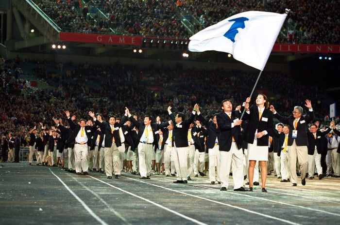 The two Korean Olympic teams under the same flag in a gesture of reconciliation during the opening ceremony of the Sydney 2000 Olympic Games.