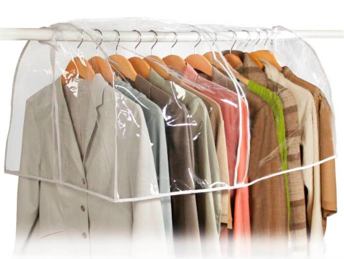 """Promising review: """"This garment cover works so well in my closet. It's clear, so you can see the clothes well, and it has a seam in the middle so you can flip up either side to easily get at your clothes. It was easy to mount and it has ties on both ends to keep it in place."""" —RSHGet it from Amazon for $6.45."""
