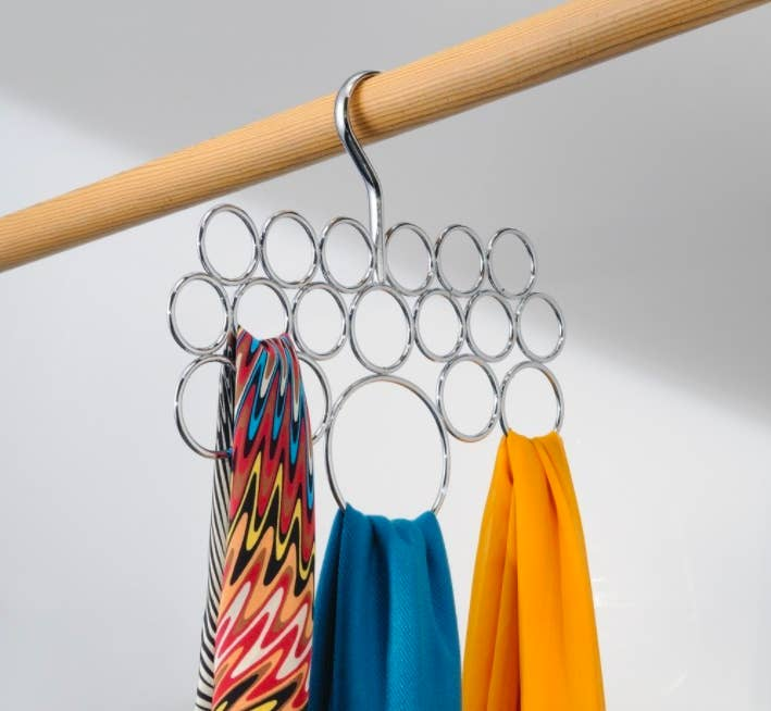 "Promising review: ""This has become a must-have in my organizational needs. I am thinking about buying a second one to separate my summer and winter scarves. Scarves are important to me because I live in Alaska. Not only do they give a flair of fashion, I also use them functionally. And this makes it easy to quickly pair a matching scarf with my outfit for the day. I like that it is a weighted metal and silver. It doesn't bend under the weight of the scarves, doesn't lose its shape, and it doesn't show any scuffs or scratches."" —FeliciaGet it from Amazon for $7.87 (available in seven colors)."