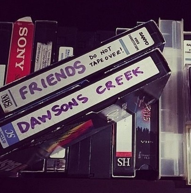 A photo of two blank VHS tapes one labeled Friends -- Do Not Tape Over and the other Dawson's Creek