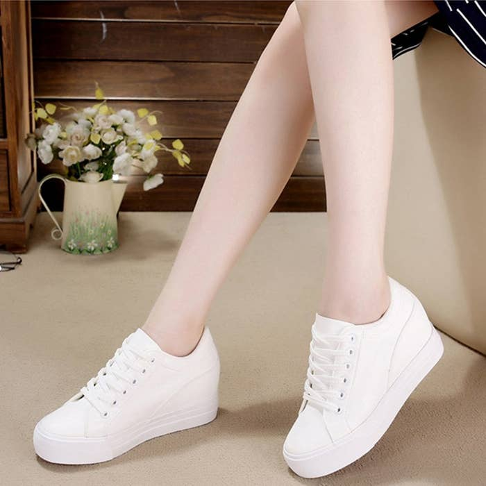 14f98b9b2fc A pair of sneakers with hidden heels so you can get some height without  sacrificing your sporty comfort.