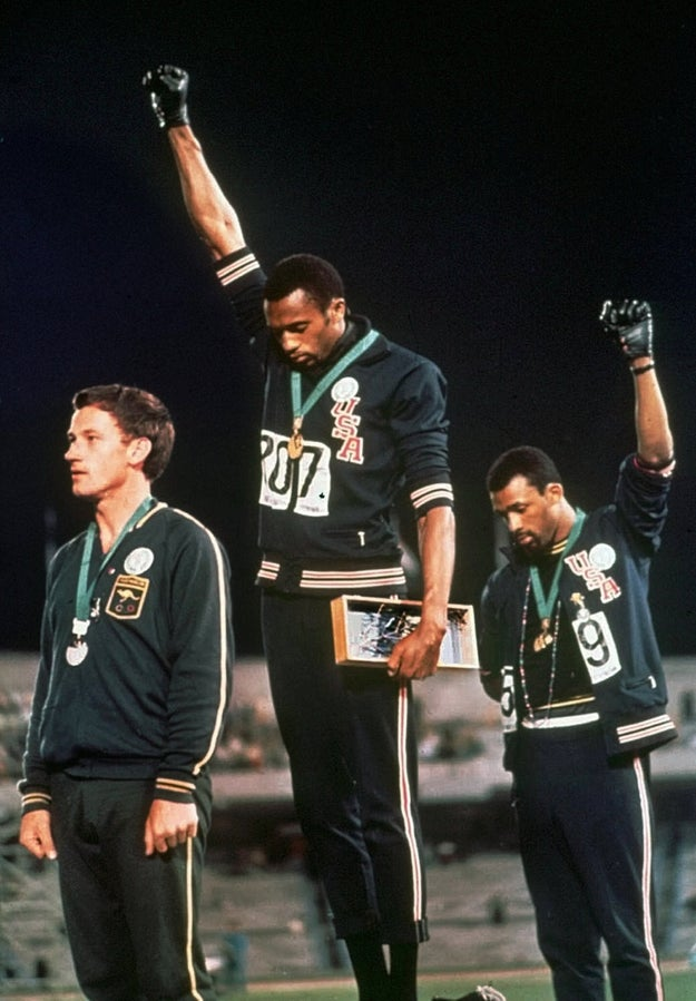 Tommie Smith (center) and John Carlos of the USA each extend a gloved fist in racial protest in 1968.