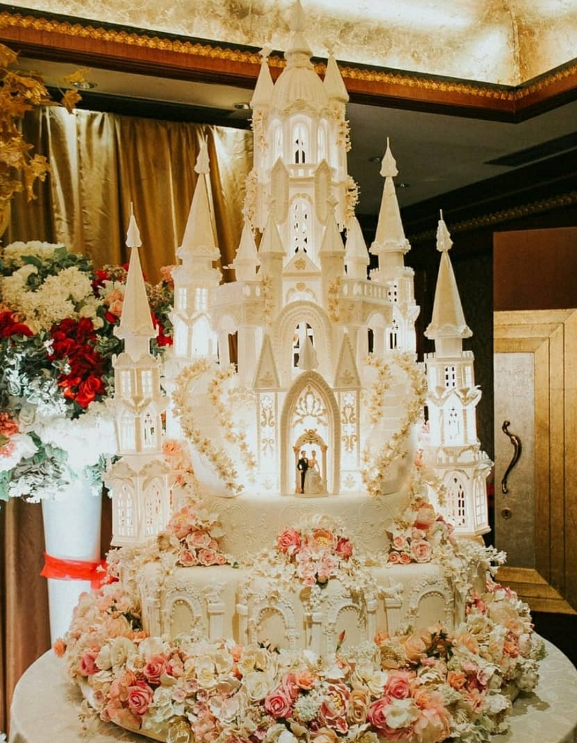 layered and intricate wedding cake with detailed flowers