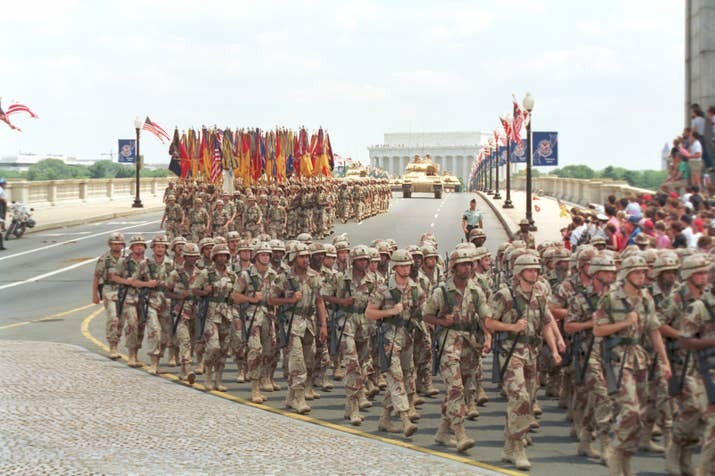 Troops march over the Memorial Bridge in Washington, DC, on June 8, 1991.