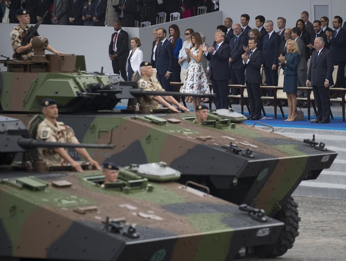 Tanks parade past President Trump, first lady Melania Trump, French President Emmanuel Macron, and his wife, Brigitte Macron, during Bastille Day.